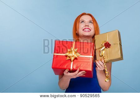 Holiday. Red Haired Happy Girl With Chrismas Gift Boxes Looking Up