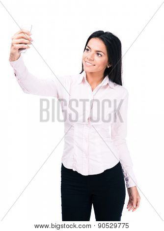 Happy businesswoman making selfie photo on smartphone isolated on a white background