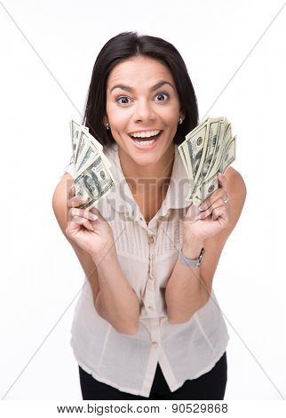 Laughing young woman holding money over white background and looking at camera