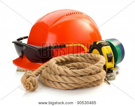 construction helmet and tools isolated on white background