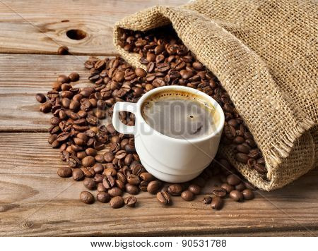Coffee cup on grunge wooden table background