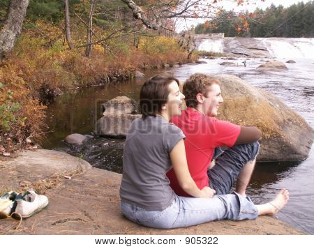 Couple Laughing By Water