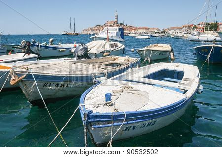 Boat Marina With Town Of Rovinj In Background