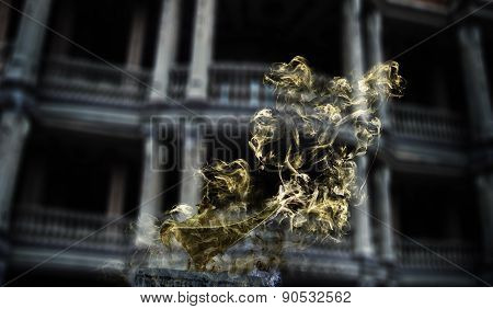 Aladdin's magic lamp in smoke on gothic halloween background