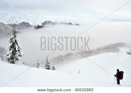 A Tourist In Winter In The Mountains Of Carpathians