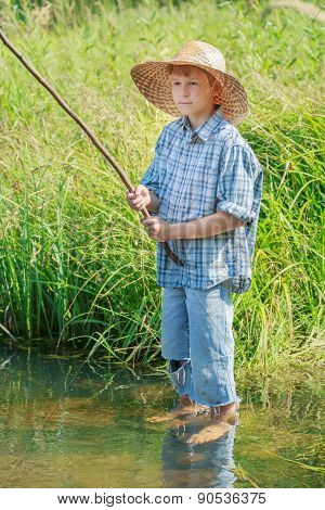 Barefoot Angler Boy Fishing Standing In Transparent Freshwater Pond