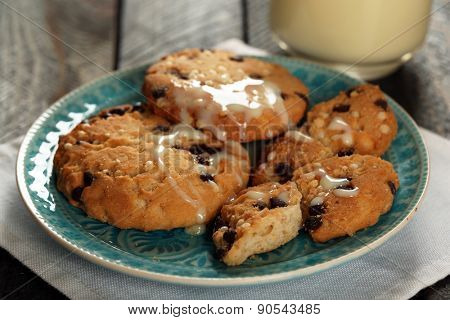 Cookies on plate with condensed milk on table close up