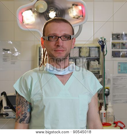 Portrait Of  Male Nurse Icu  With Tattoo And Dreadlocks.