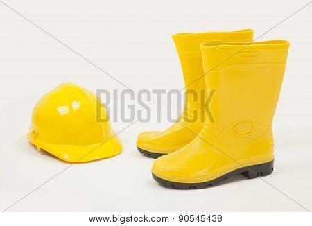 Yellow gumboot and protective helmet