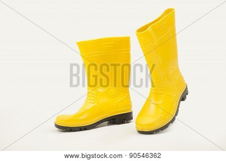 Yellow gumboot with different angles on white