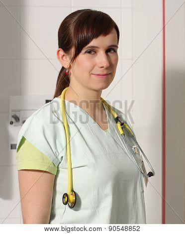 Portrait Female Nurse In Icu In Green Uniform.