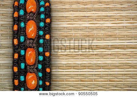 straw background with beads