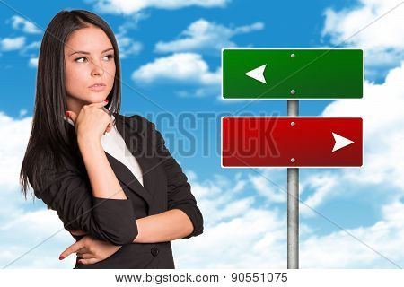 Thoughtful businesswoman looking to right side