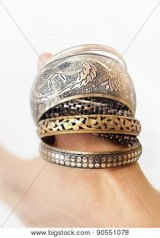 Feminine Bracelets On A Man's Thumb