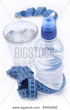 Bottle Of Water, Glass Of Water And Measuring Tape