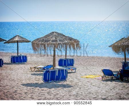 Beach with sunumbrellas and sunbeds