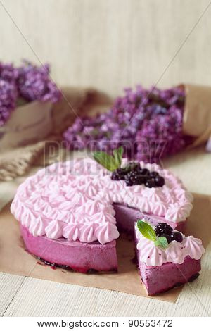 Berry purple mousse cake. Delicious homemade baked sweet decorated with blackberry and whipped cream