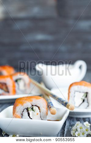 Sushi Roll On White Plate,