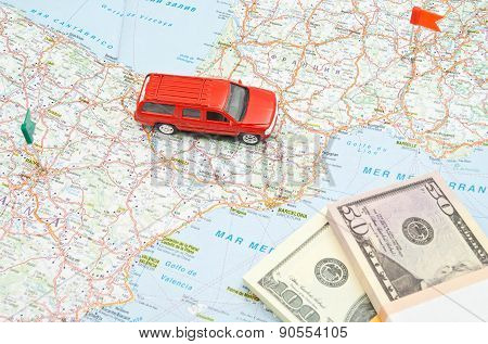 Red Car And Money On Map
