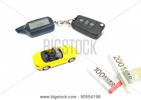 Sport Car, Keys And Money On White