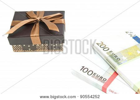Banknotes And Brown Gift Box