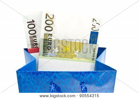 Blue Gift Bag With Banknotes On White