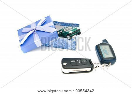 Car Keys, Green Car And Blue Gift Box