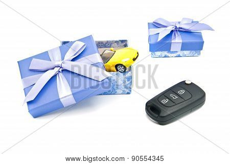 Car Keys, Yellow Car And Blue Gift Boxes
