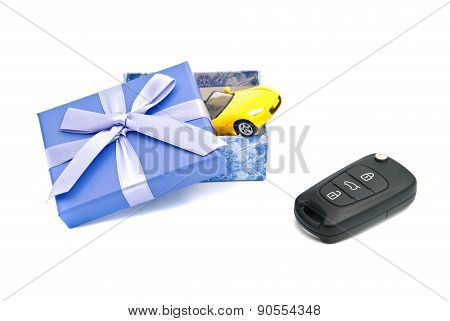 Car Keys, Yellow Car And Blue Gift Box