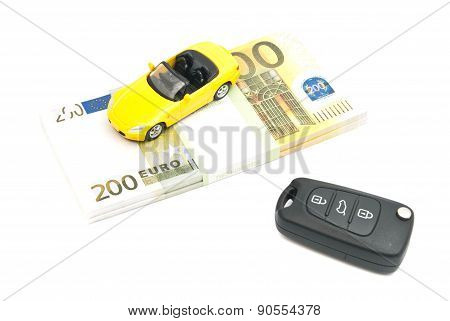 Keys, Yellow Car And Banknotes