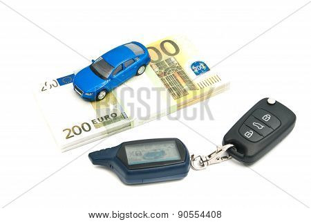 Car Keys, Blue Car And Banknotes