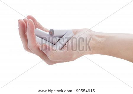 Female Hand Kept In An Armful Batteries