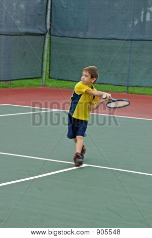 Boy Playing Tennis