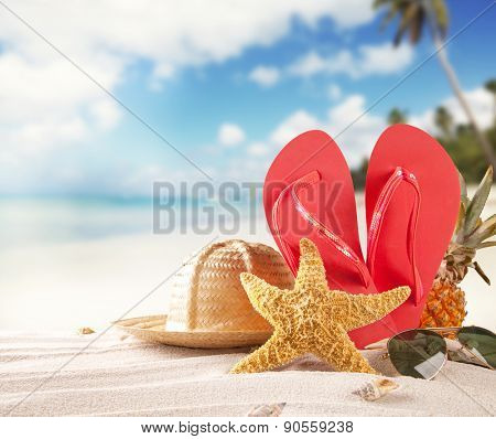Summer beach with accessories. Blur azure sea on background