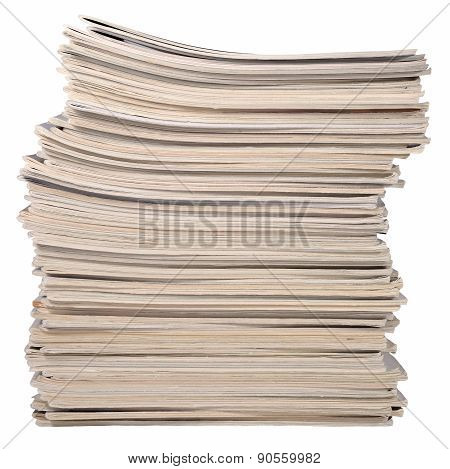 Stack Of Old Magazines On A White