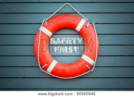 Safety First. Red Lifebuoy Hanging On Blue Wall