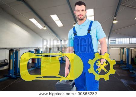 Repairman with toolbox against empty work stations