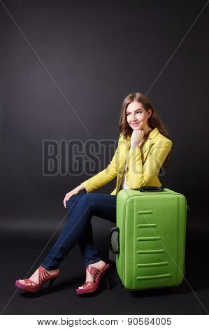 Pretty Woman Waiting With A Suitcase
