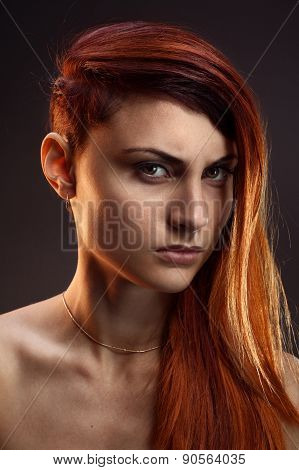 Portrait Of A Beautiful Girl With Red Hair