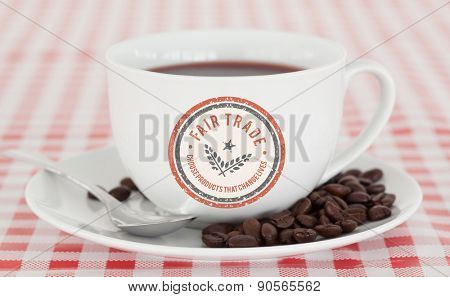 Fair Trade graphic against coffee and beans on a tablecloth