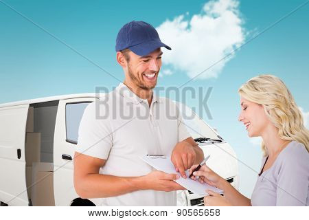 Happy delivery man getting signature from customer against blue sky
