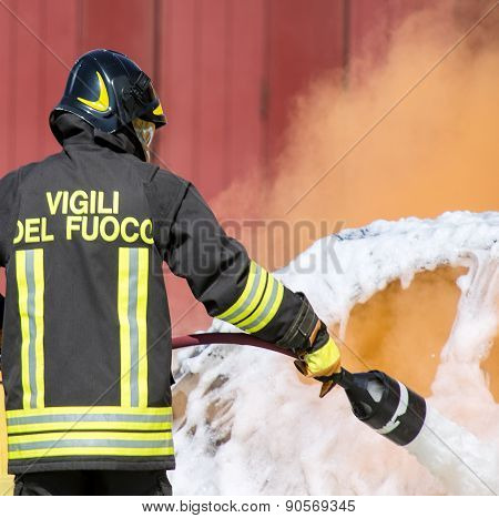 Firefighters In Action With Foam
