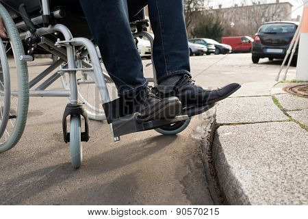 Man Sitting On Wheelchair