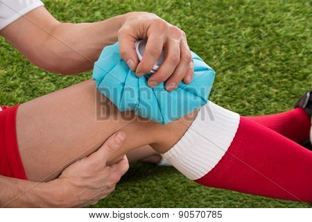 Soccer Player Icing Knee With Ice Pack