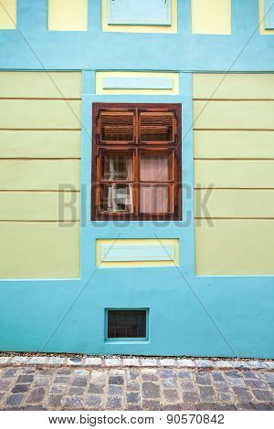 Blue House Facade With Wooden Window From Sighisoara City Old Center