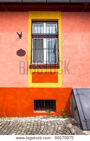 Orange House Facade With Wooden Window From Sighisoara City Old Center