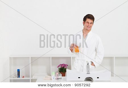man using mouthwash in bathroom