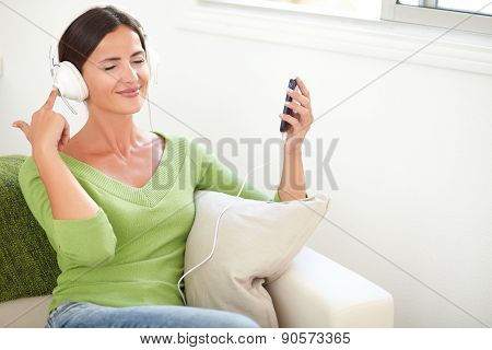 Young Caucasian Woman Listening To Music
