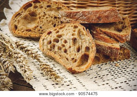 Sliced bread on a white tablecloth