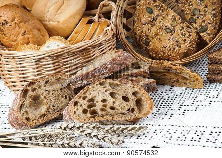 Sliced bread on a tablecloth and in a basket